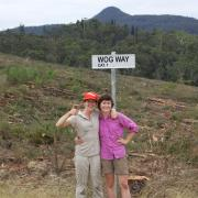 kika and erin standing next to wog rd. sign