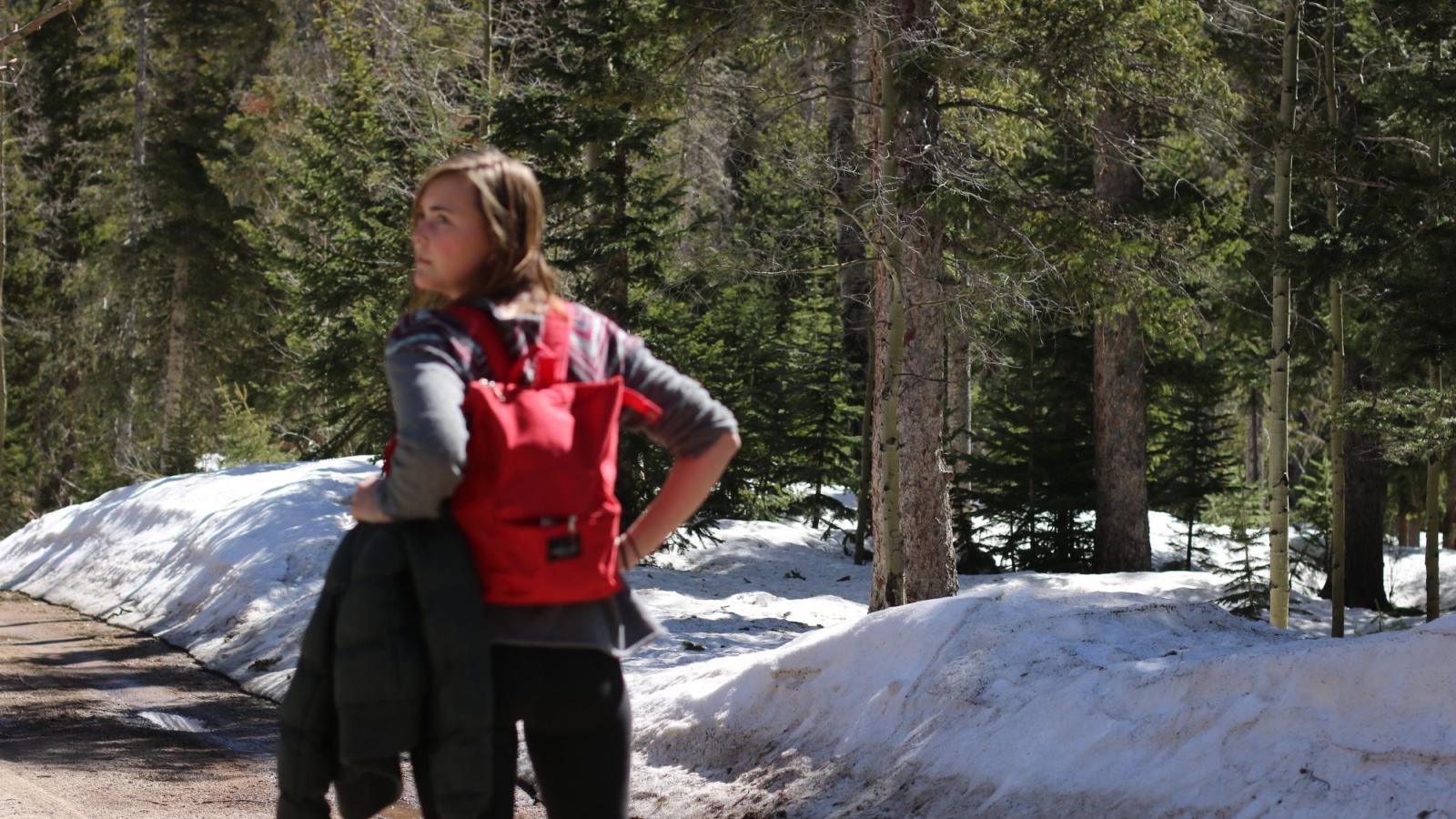 Rutledge walking in snowy trail in boulder co