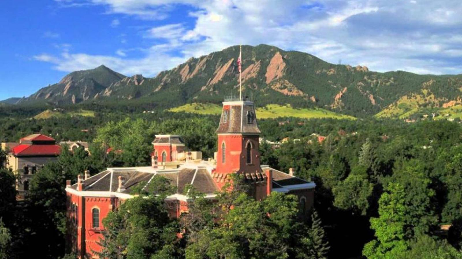 Old main building in front of the flatirons