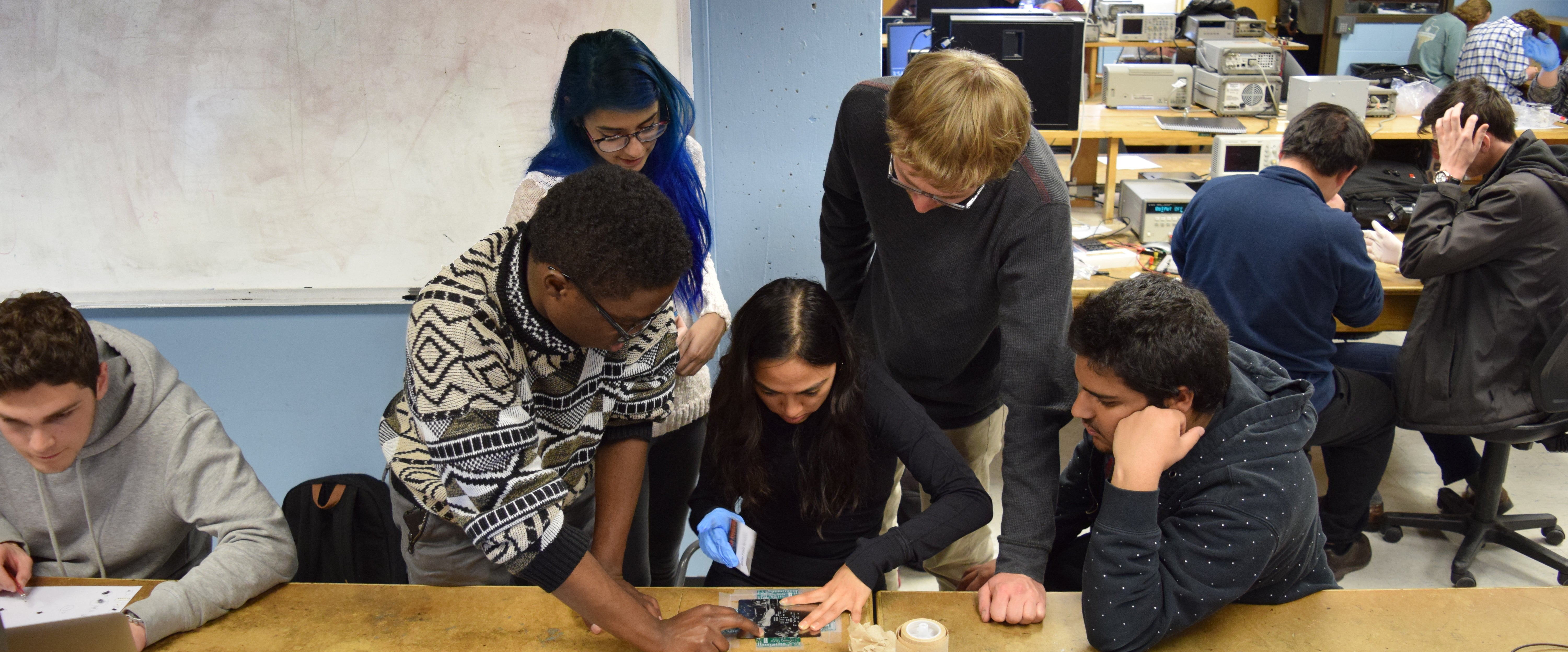 Students work on a group stencilling project during a lab section.