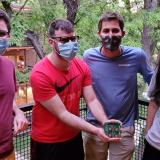 Four masked team members show off their prototype during a testing session at a team member's home.