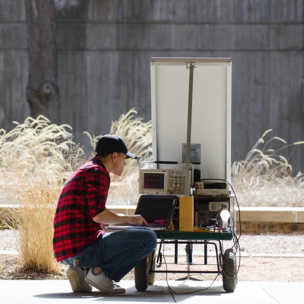 A student collects data with a solar cart