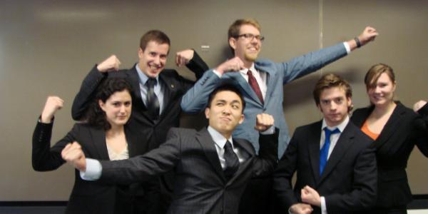 The members of Team Myoelectric pose like superheroes