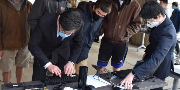 Members of the Cutting Edge team demo their device for guests at the ECEE senior design expo