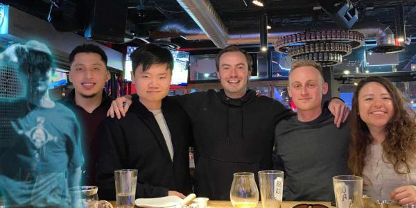 The Optimus Climb team shares a meal as a team-building event
