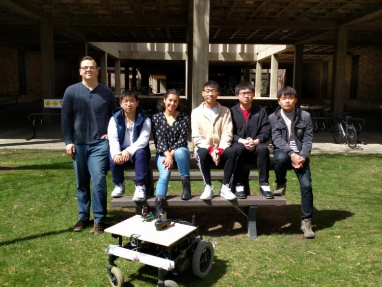 The team with their prototype outside the Engineering Center.