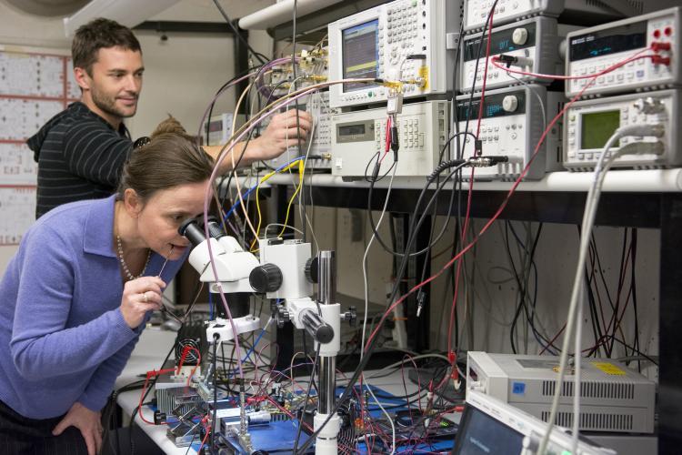 Zoya Popovic looking in microscope
