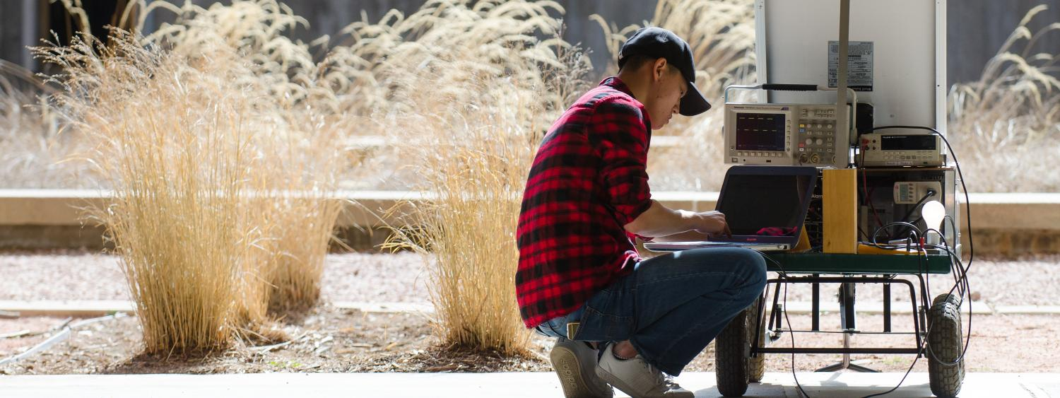 Electrical Computer Energy Engineering University Of Colorado Education Block Diagram A Student Works With Solar Test Cart In The Center Courtyard