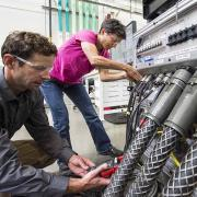NREL researchers work on the Consolidated Utility Base Energy System (Photo credit: Dennis Schroeder, NREL)