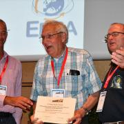 Barnes receives an award on stage at BIOEM 2019