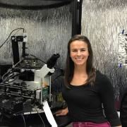 Callie Higgins with her hybrid atomic force microscope 3D printer.