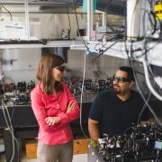 Gopinath discusses a project with a postdoc in her lab.