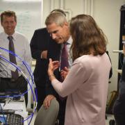 Lockheed Martin CTO Keoki Jackson and Distinguished Professor Zoya Popovic discuss a project in her RF laboratory
