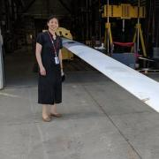 Lucy Pao with one of the blades at NREL.