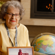 Irene Peden holds a photo from her Antarctic trip
