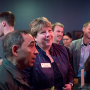 Fiez chats with fellow attendees at the 2019 New Venture Challenge Finals at the Boulder Theater.