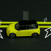 """An illustration of a car traveling down the """"charging lane"""" of a highway."""