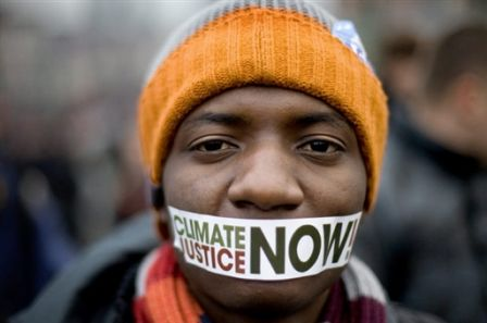 Man with mouth taped shut for climate change justice