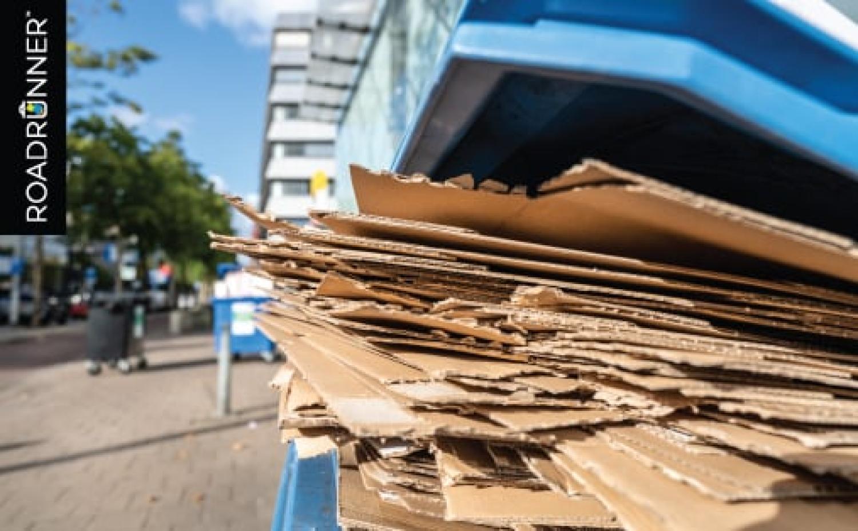 Flattened cardboard in a recycle bin