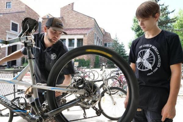 mechanics work on a bicycle