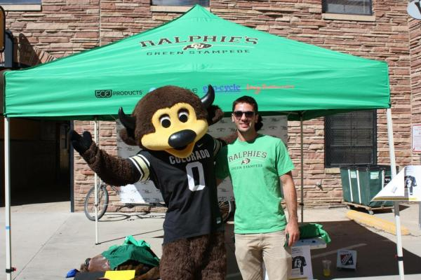 Chip with Ralphie's Green Stampede volunteer at Folsom Field
