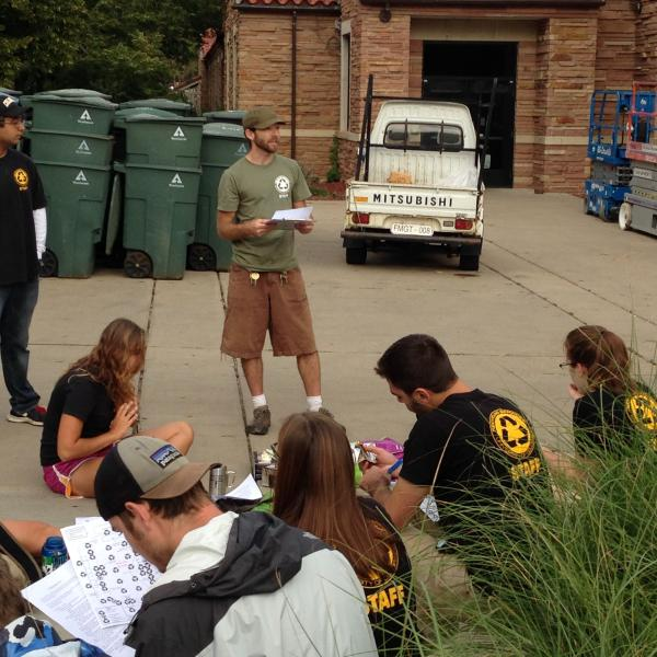 students and faculty at zero waste event going over notes
