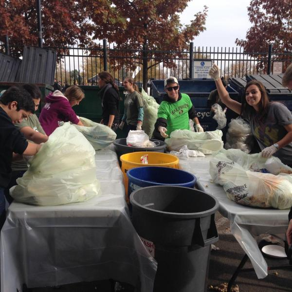 Students sorting waste after a home football game