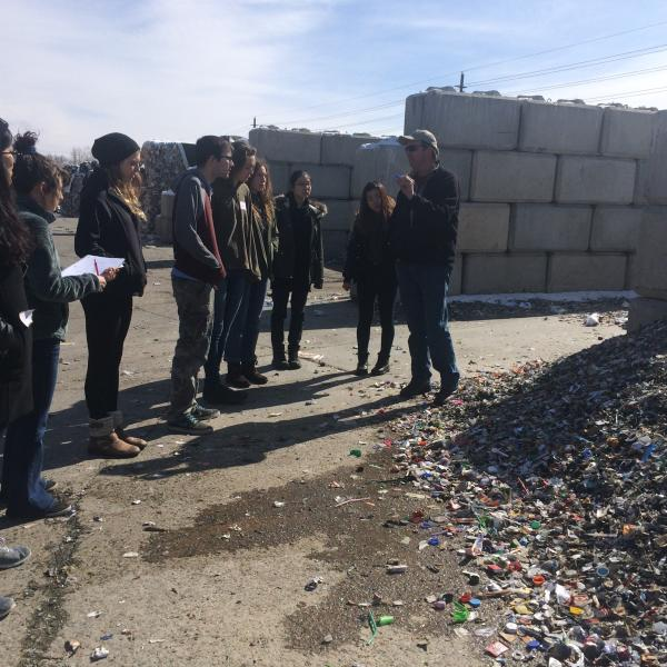 students and faculty at recycling facility