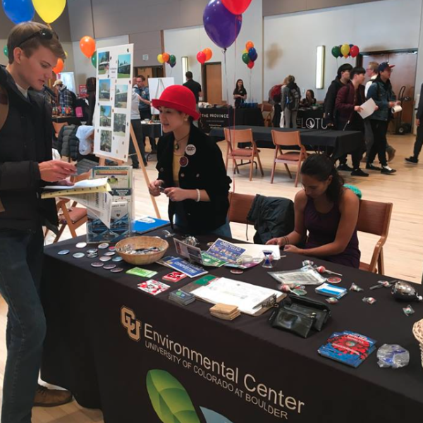 students talking at an environmental center tabling event
