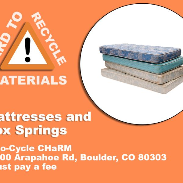 Stack of mattresses; these can be recycled at Eco-Cycle CHaRM at 6400 Arapahoe Rd, Boulder, CO 80303. There is a service fee.