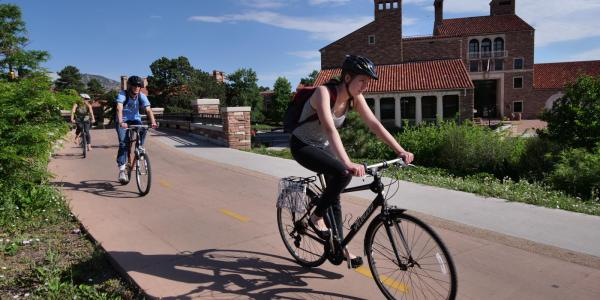 student riding bike near UMC
