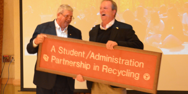 Dave Newport presents Jack DeBell a recycling sign