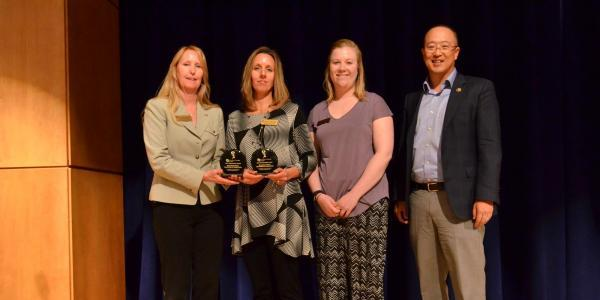 staff accept campus sustainability awards
