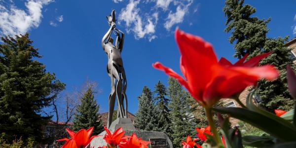 statue with flower