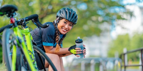 Woman in helmet with bike