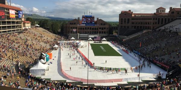 wide shot of stadium with runners