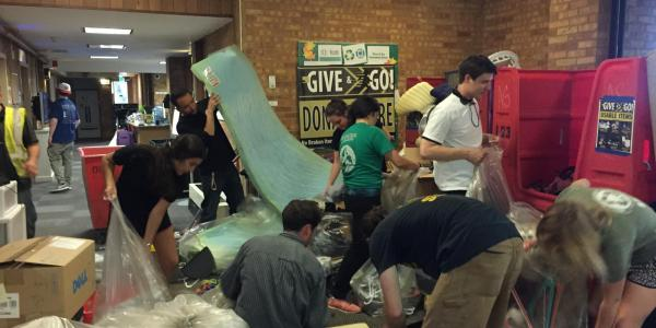 staff sort a variety of donated items