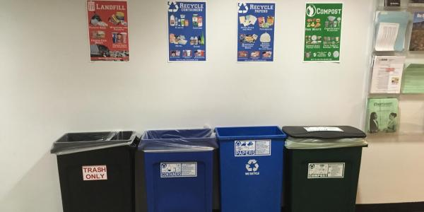 Posters above bins in UMC