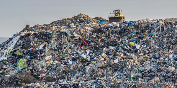Landfill with tractor on top