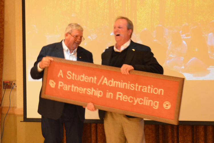 Environmental Center Director presents Jack DeBell with a sign