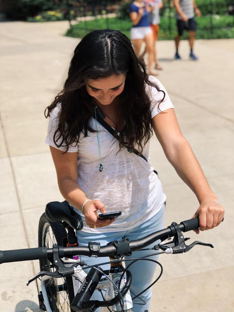 student scans bike QR code