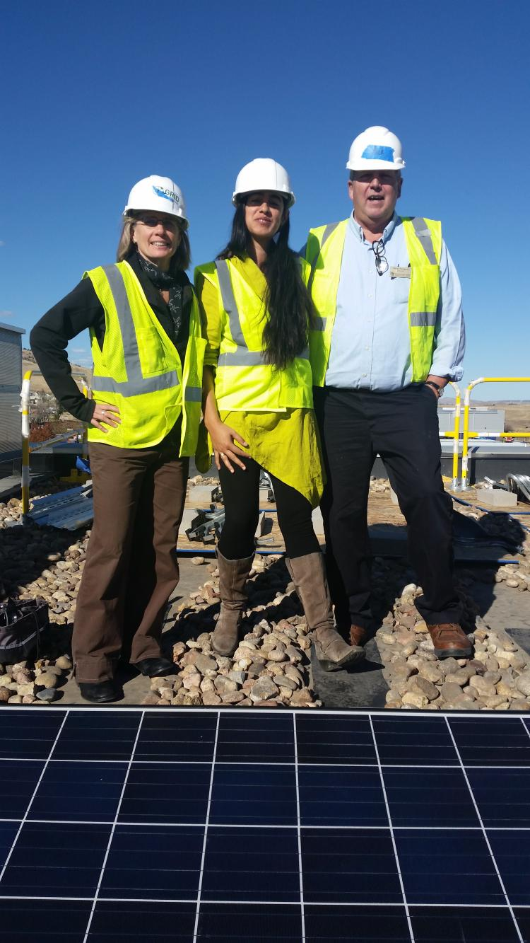 Photo of program manager, Michelle Gabrieloff, Director Dave Newport and Boulder Mayor Suzanne Jones on top of Boulder Housing Partners Roof during inauguration of solar installation with GRID Alternatives