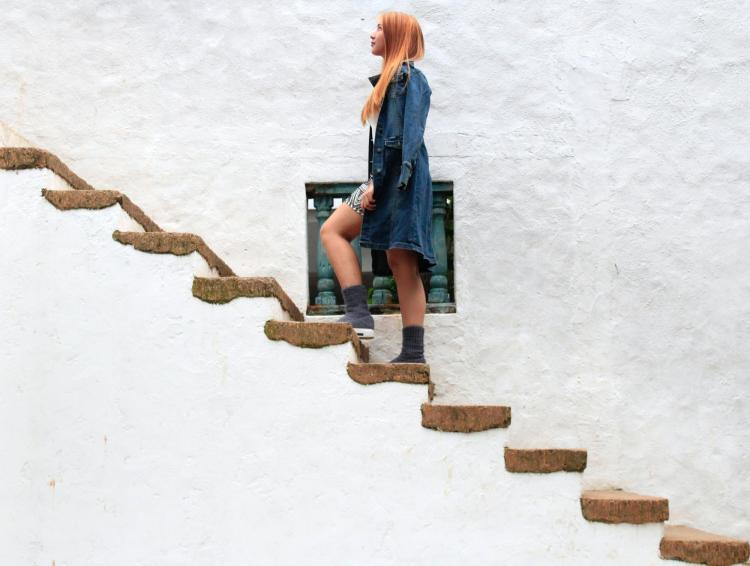 a woman walking up stairs