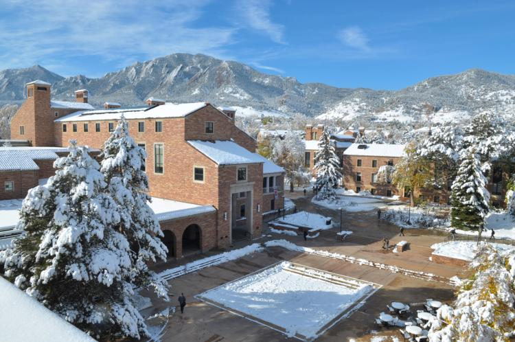 UMC with flatirons in the background covered in snow