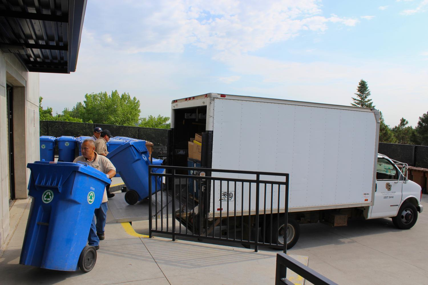 Facilities Management Crews unload full Recycling Poly-Carts
