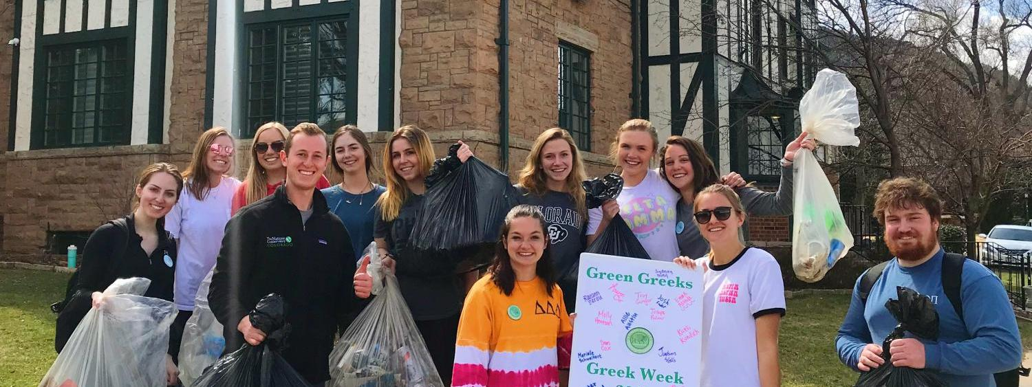 photo of members of the greek community helping Green Greeks with a trash and recycling cleanup on the hill