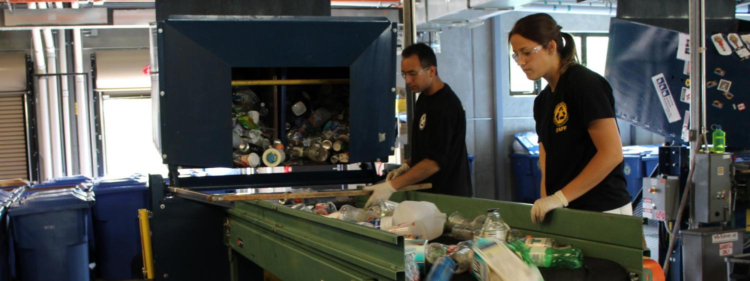Students sorting recycling on the containers line