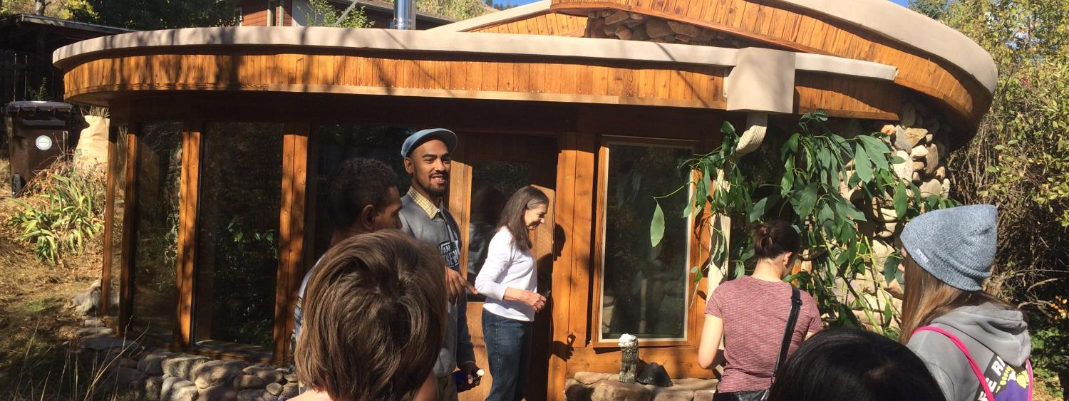 Students outside an Earthship