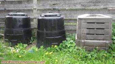 three backyard compost 'barrels'