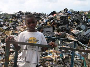 A boy standing in a landfill